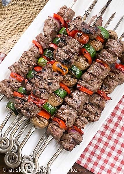 Overhead view of skewered Beef Teriyaki Kabobs on a white rectangular platter