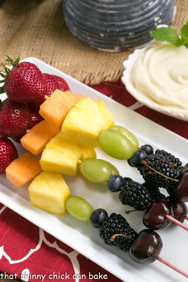Fruit Kebabs with White Chocolate Mascarpone Dip on a rectangular white ceramic tray