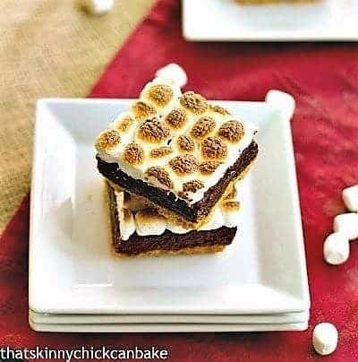 S'mores Brownies on a stack of square white plates