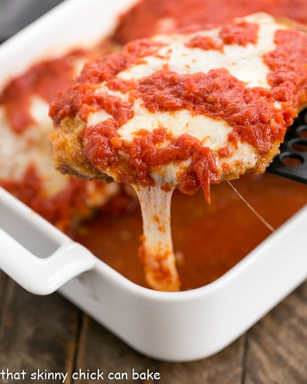 Chicken Parmesan A terrific weeknight dinner of breaded chicken topped with cheese and marinara