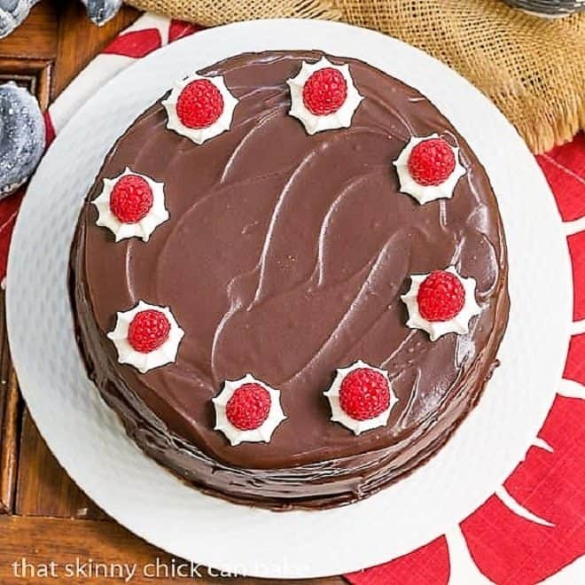 Cheesecake Filled Chocolate Cake on a white plate viewed from above