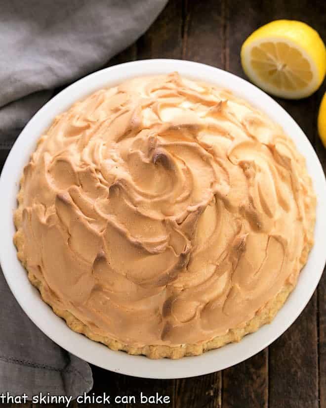 Overhead view of lemon meringue pie in a white ceramic pie plate