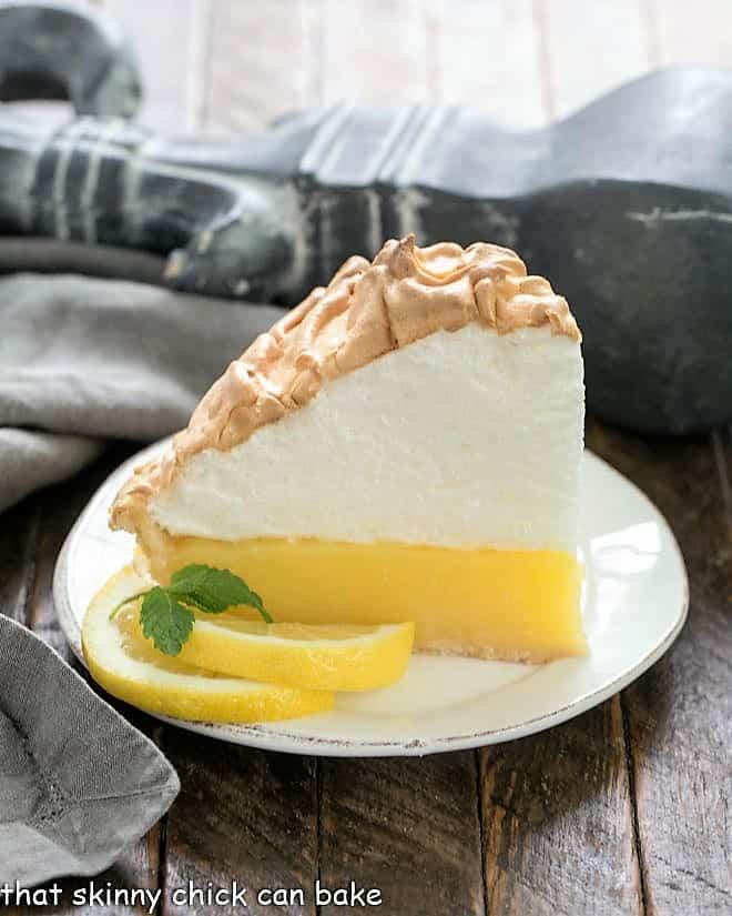 Slice of Mile High Lemon Meringue Pie on a white plate