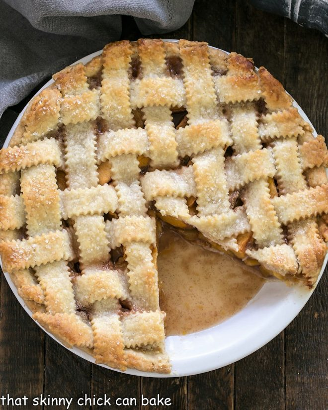 Peach Pie with a lattice crust with a slice removed