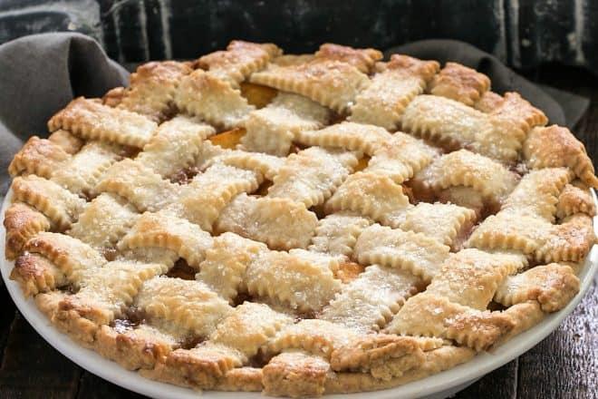 Side view of lattice topped peach pie recipe