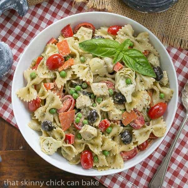 Pesto Pasta Salad in a round white serving bowl