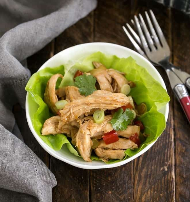 Shredded Chicken Lettuce Wraps in a white bowl with two forks