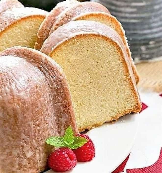 Sour cream pound cake with two slices removed on a cake plate