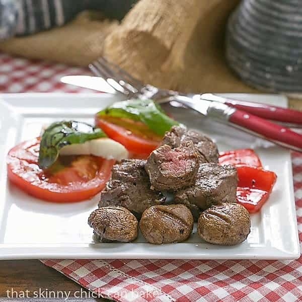 Tender Beef Steak Kabobs on a white plate