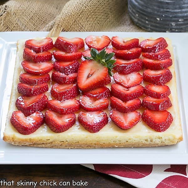 Strawberry Cheesecake Bars topped with sliced berries