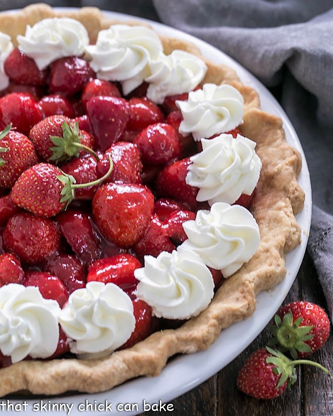 Overhead view of half a Fresh Strawberry Pie in a white pie plate