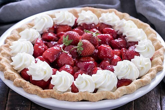 Fresh strawberry pie in a white pie plate