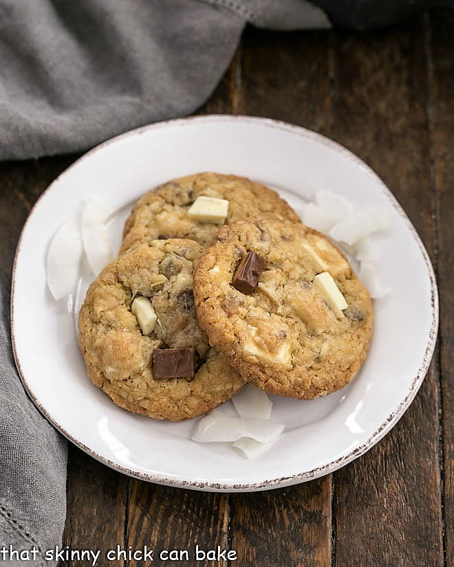 3 Chewy Oatmeal Toffee Cookies on a round white dessert plate