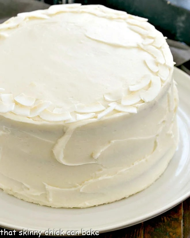 Siide view of anItalian Cream Cake on a white serving plate