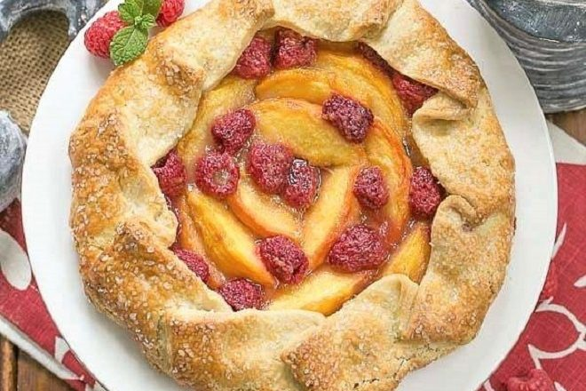 Overhead view of Peach Raspberry Galette on a white ceramic cake stand