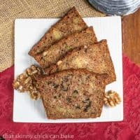Slices of Pineapple Coconut Zucchini Bread fanned out on a square white plate