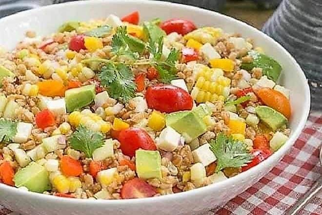Summer Farro salad in a white serving bowl