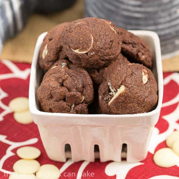 Triple chocolate chip cookies in a white ceramic basket
