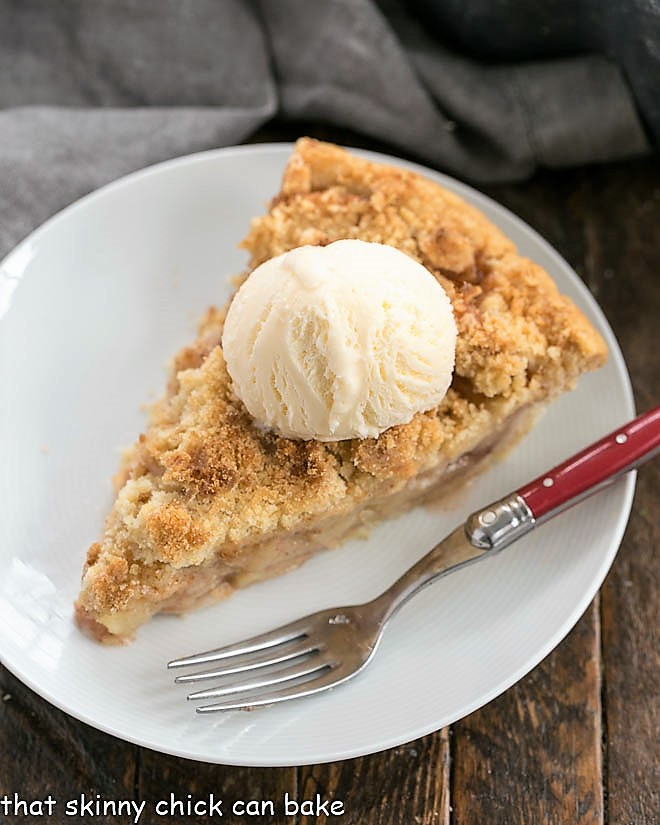Dutch Apple Pie slice on a white plate with a red handled fork