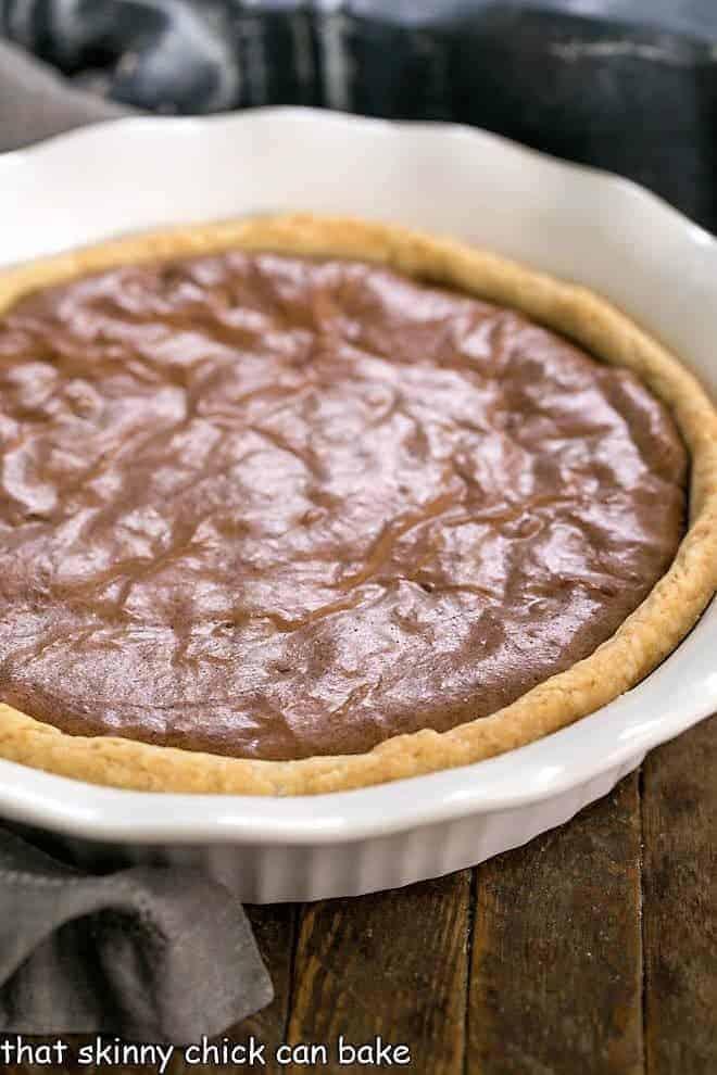 Fudgy Brownie Pie in white, fluted ceramic pie plate