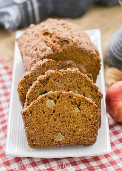 Slices of Pumpkin Bread with Apples on a white platter