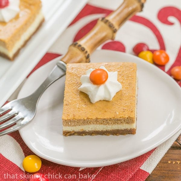 Pumpkin Cheesecake Bars Biscoff crust topped with a layer of plain then pumpkin cheesecake!