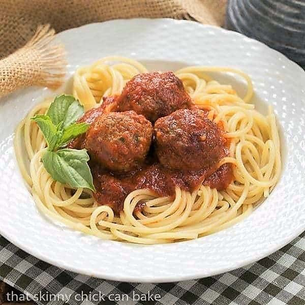 Classic Italian Meat Sauce in white bowl garnished with basil