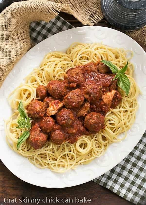 Classic Italian Meat Sauce over pasta on a white platter