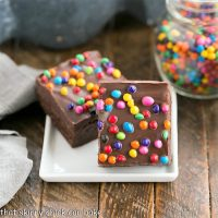 2 cosmic brownies on a small square white plate