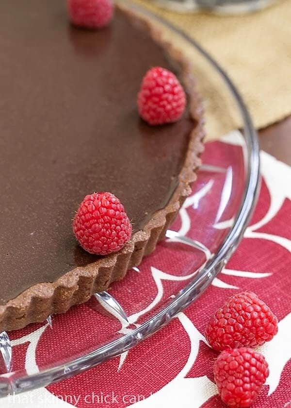 Close view of Dark Chocolate Tart garnished with raspberries