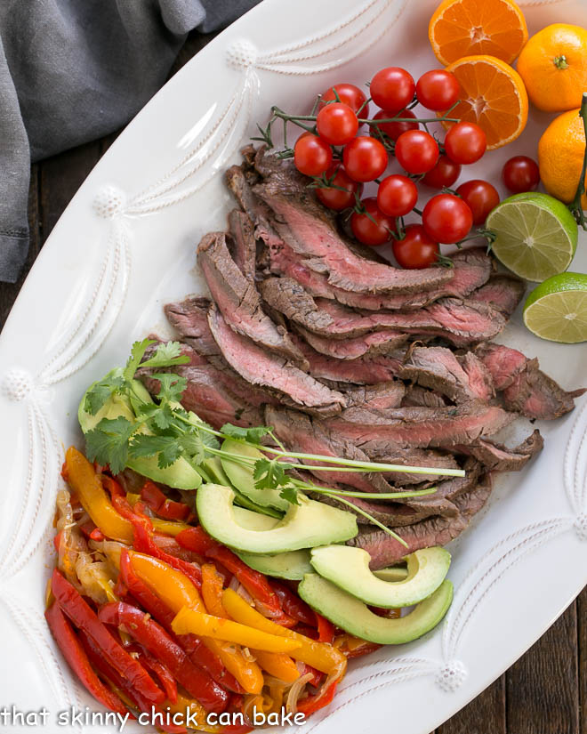 Easy Steak Fajitas Recipe and toppings from above on a white tray