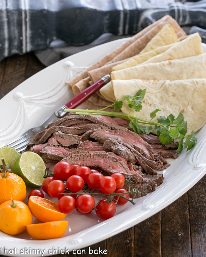 Beef Steak Fajitas sliced and on a tray with all the fixings!