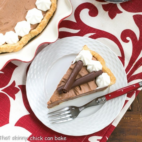 A slice of Classic French Silk Pie on a plate with a red handled fork