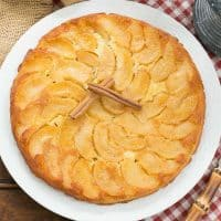 Overhead view of german apple pancake topped with cinnamon sticks