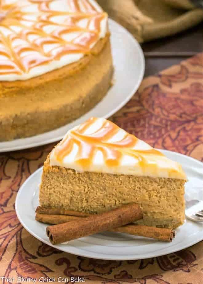 A slice of Caramel Topped Pumpkin Cheesecake on a white dessert plate