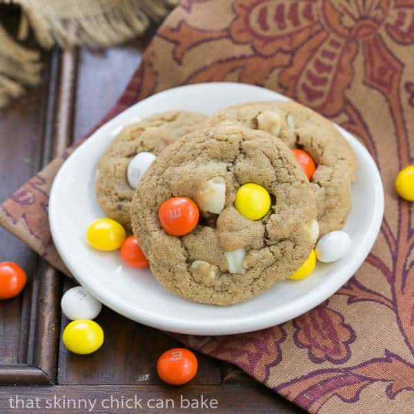 3 M&M White Chocolate Macadamia Nut Cookies on a small white plate