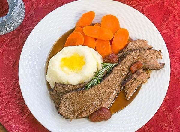 Rosemary Garlic Brisket | Slow Cooked with red wine and herbs makes a tender, irresistible entree