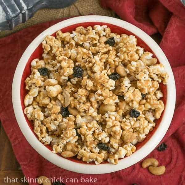 Overhead view of a bowl of homemade Caramel Corn with Cashews and Cherries