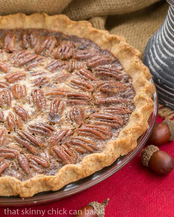 Classic Pecan Pie, spiked with bourbon in a pastry crust on a red napkin