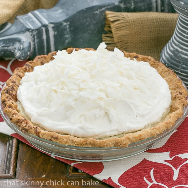 Coconut Cream Pie | Coconut crust filled with creamy coconut laden custard with a decadent whipped cream topping!