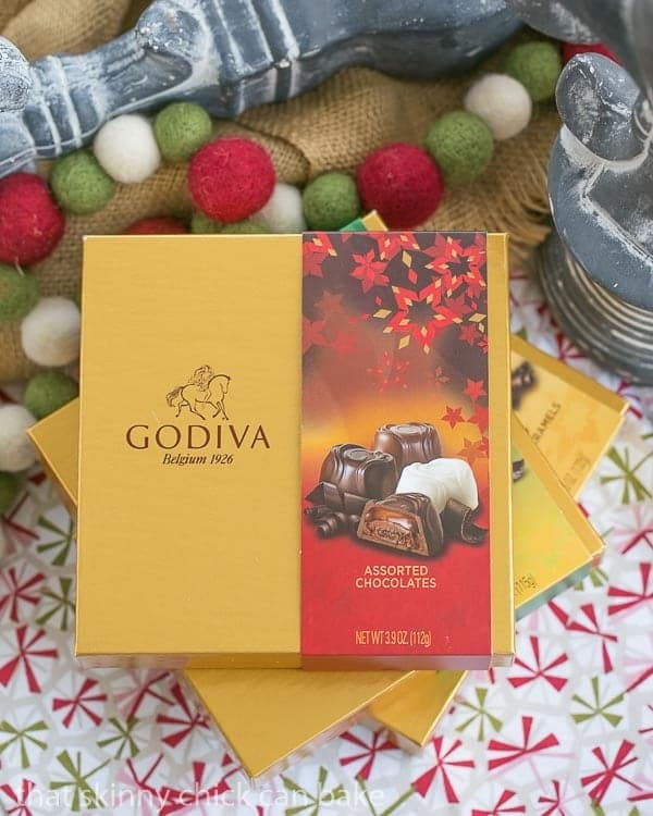 A stack of GODIVA gift boxes