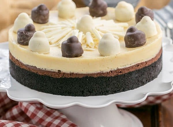 Layered Chocolate Cheesecake   A chocolate cookie crust topped with lusious dark chocolate and Frangelico white chocolate cheesecake - The perfect dessert for a holiday feast!