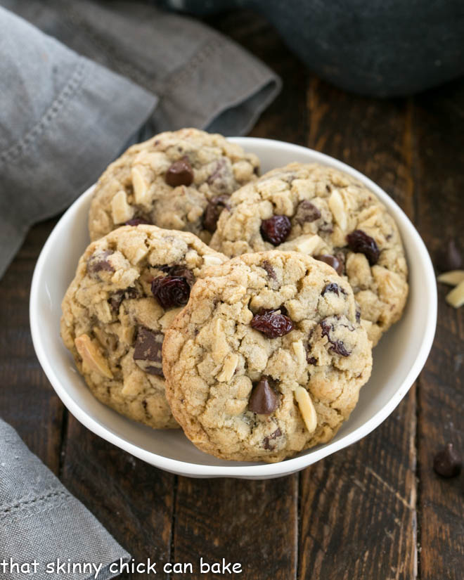 White bowl full of double chocolate oatmeal cookies