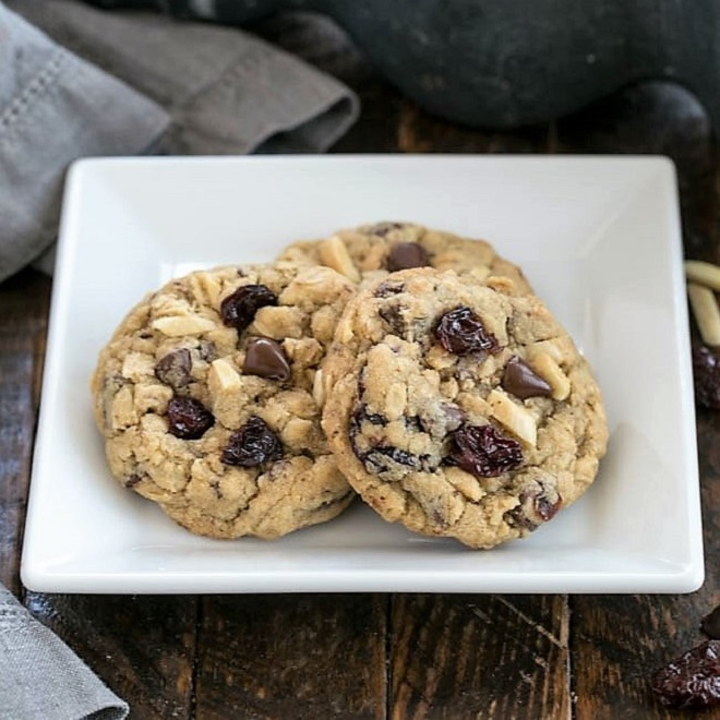 Loaded oatmeal cookies on a square white plate