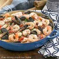Julia Child's Paella a l'Americaine in a blue paella dish