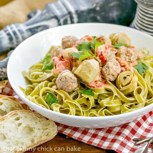 Pasta with Sausage and Cream in a white ceramic serving bowl for an Italian Holiday Feast