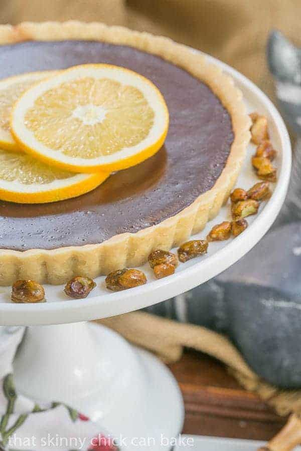 Close view of a Semisweet Chocolate Tart topped with orange slices