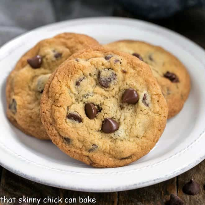 Thin and Chewy Chocolate Chip Cookies on a round white plate