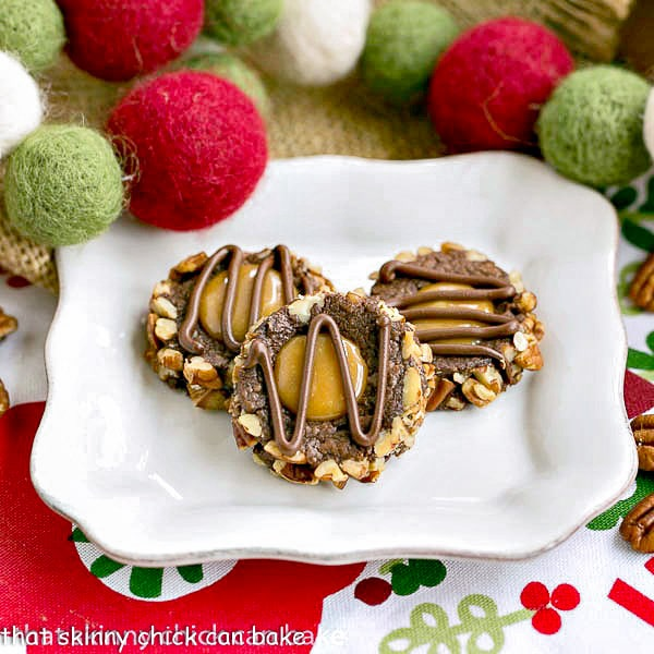 Turtle Thumbprint Cookies - chocolate thumbprints rolled in pecans and filled with caramel!