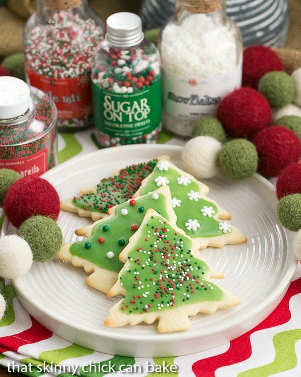 Easy Sugar Cookies with holiday frosting and sprinkles